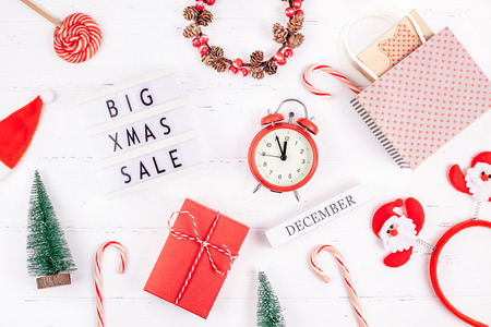 Creative Top view flat lay promotion composition Big Xmas sale text lightbox white wooden background copy space Template seasonal winter christmas offer promotion advertising scandinavian minimalism