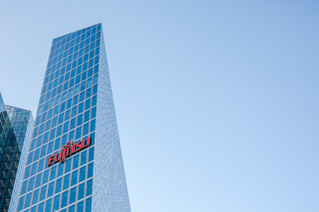 MUNICH, GERMANY - DECEMBER 26, 2018: Fujitsu logo at the company office building located in Munich, Germany