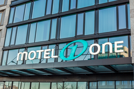 MUNICH, GERMANY - DECEMBER 26, 2018: Motel One logo at hotel building located in Munich, Germany