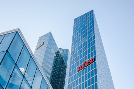 MUNICH, GERMANY - DECEMBER 26, 2018: IBM and Fujitsu logos at the companies office building located in Munich, Germany Publikacyjne