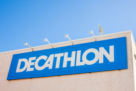 ORIHUELA, SPAIN - FEBRUARY 13, 2019: Decathlon store is a French company of sporting goods distribution retail chain brand logo at building located in Orihuela shopping area Spain. Blue sky background