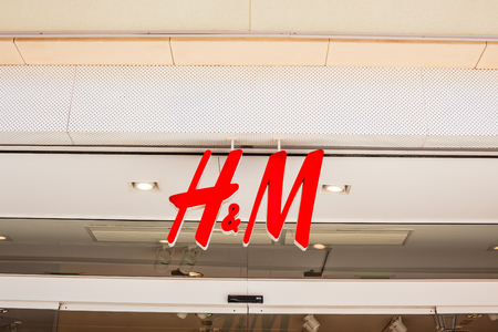 ORIHUELA, SPAIN - FEBRUARY 13, 2019: H&M store of international chain of mass fashion retail clothing stores brand logo at its building located in Orihuela shopping area Spain