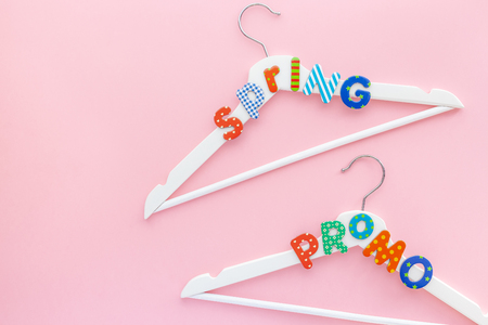 Creative top view flat lay white wooden hangers spring promo text pastel pink background with copy space minimalism style Template fashion feminine blog social media sale store design shopping concept 版權商用圖片