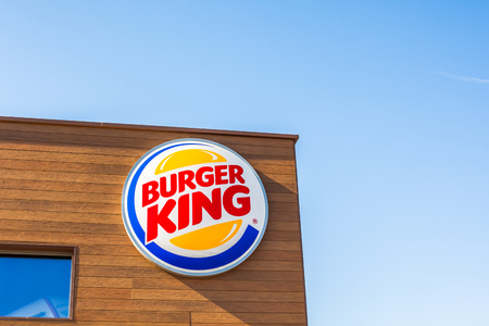 SAGUNTO, SPAIN - FEBRUARY 08, 2019: Burger King fast food restaurant logo at its building located in Sagunto shopping area, Spain. Clear bright blue sky Editorial
