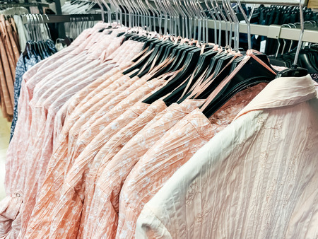 Female Clothes on racks at a Fashion Store. Mobile photo 写真素材