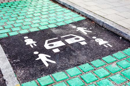 Carsharing vehicle parking sign on asphalt road of Munich, Germany, Europe. Modern rental ideology transport concept