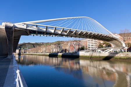 The Zubizuri, the Campo Volantin Footbridge in Bilbao, Spain, modern pedestrian tied arch crossing of the Nervion River by Santiago Calatrava architect