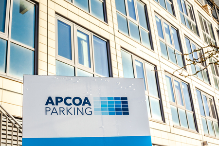 MUNICH, GERMANY - DECEMBER 26, 2018: APCOA Parking brand logo on the building in Business Park of Munich, Germany. APCOA Parking AG is Europe full service parking management company.