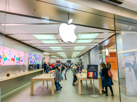 LYON, FRANCE - FEBRUARY 27, 2019: Apple store of American multinational technology company brand logo at its shop located in Lyon shopping mall France. Mobile photo