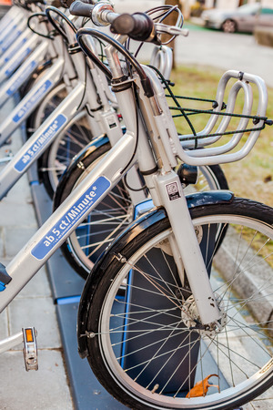 MUNICH, GERMANY - DECEMBER 26, 2018: City renting Bicycles Parked In Row in Business Park of Munich, Germany Editöryel