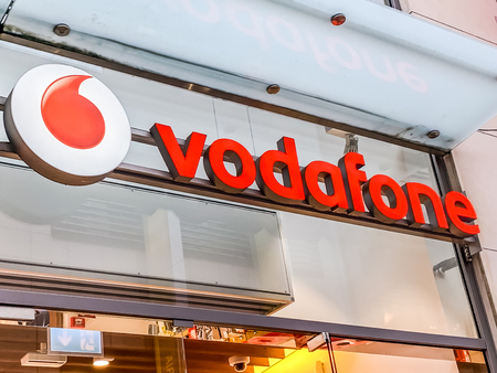 AACHEN, GERMANY - MARCH 01, 2019: Vodafone store of British multinational telecommunications conglomerate brand logo located in Aachen shopping street Germany. Mobile photo