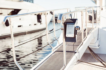 Bridge of private luxury ship with modern intercom system on entry in Marina of Cannes, French Riviera, France Stock Photo