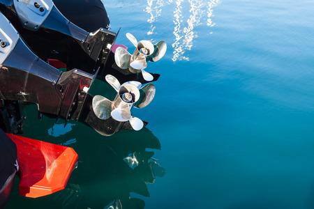 Two motor boat screws on sea water background. Horizontal day shot Stock fotó