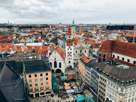 MUNICH, GERMANY - DECEMBER 23, 2018: Christmas market Christkindlmarkt on square Marienplatz in Munich. Aerial view from Rathaus Turm tower. Mobile photography