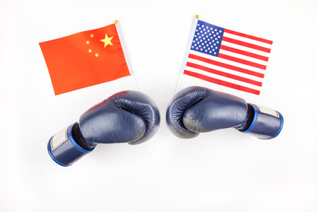 Creative top view flat lay of Two boxing gloves with China and USA flag and copy space on white background in minimal style. Concept of trade war between USA and China Banque d'images - 122715498