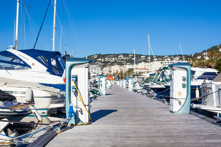 Moored yachts charching with fuel and electricity in Marina of Cannes, France 版權商用圖片