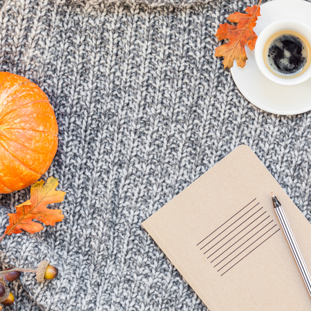Creative square autumn flat lay overhead top view stylish home workspace with notebook coffee cup cozy gray knitted plaid background copy space. Fall season template for feminine blog social media Banco de Imagens