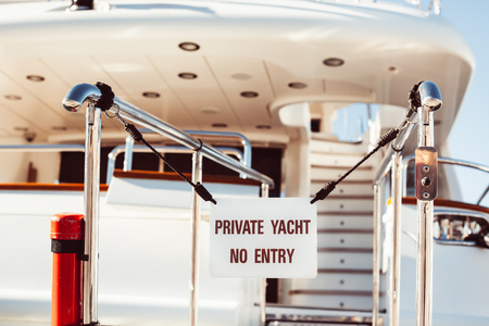 Bridge of private luxury ship with prohibited entry sign Private yacht No entry in Marina of Cannes, French Riviera, France