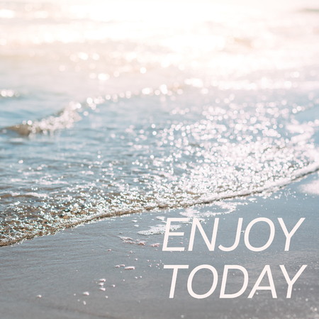Summer sand beach and seashore waves background. Defocused blurred square holiday vacations concept with motivational quote Enjoy today Imagens