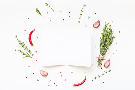 Flat lay overhead view blank notebook pages mockup text space invitation card on white background with greens herbs and spices. Menu or recipe book or food blog design with cooking ingredients