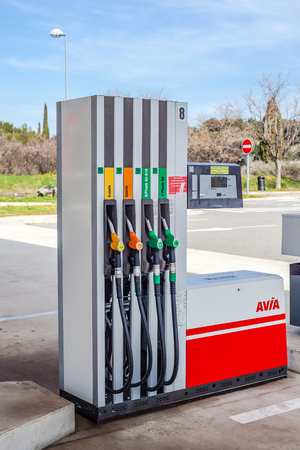 LYON, FRANCE - FEBRUARY 26, 2019: Petrol pump nozzles on a AVIA gas service station. Day shot Editorial