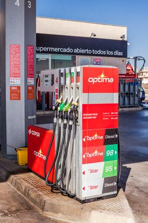 VALENCIA, SPAIN - FEBRUARY 19, 2019: Cepsa Petrol pump nozzles on a gas service station in Valencia, Spain