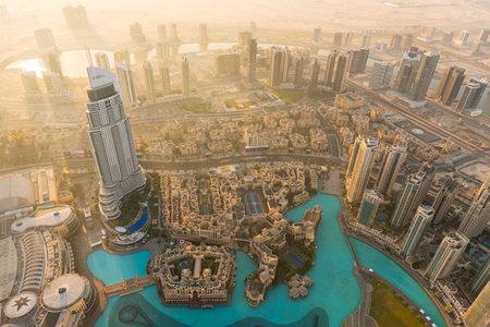 DUBAI, UAE - JANUARY 02, 2015: Dubai downtown golden sunrise morning scene. Top view from above Sajtókép