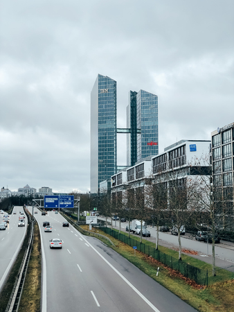 MUNICH, GERMANY - DECEMBER 24, 2018: Business park along the highway with IBM and Fujitsu logos at the companies office building located in Munich, Germany. Mobile photo Editöryel