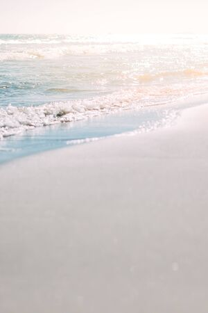 Summer sand beach and seashore waves background. Defocused holiday vacations concept backdrop for motivational quotes, blog posts, your text