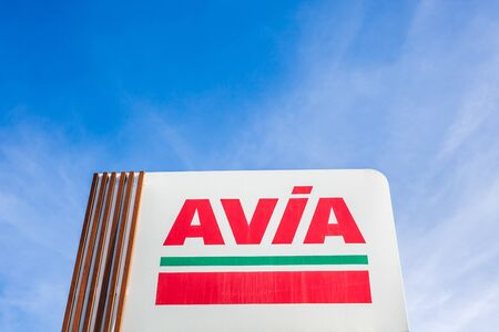 LYON, FRANCE - FEBRUARY 26, 2019: AVIA, Swiss oil and gas company logo on its gas service station in Lyon, France on blue sky background