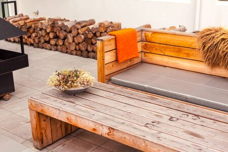Outdoor restaurant terrace with wooden furniture in scandinavian style. Eco-friendly authentic design. Фото со стока