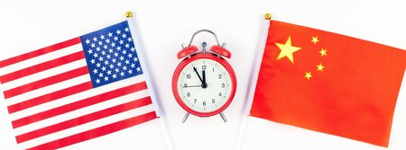 Creative top view flat lay of China and USA flag red alarm clock and copy space white background in minimal style. Concept of trade war between USA and China