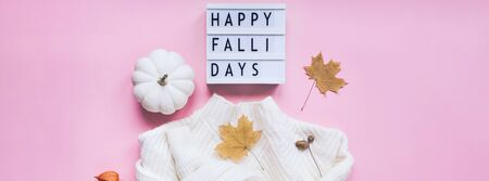 Creative autumn flat lay top view white cozy sweater pumpkin leaves lightbox Happy fallidays text on millennial pink background copy space minimal style Fall season composition for feminine blog Reklamní fotografie
