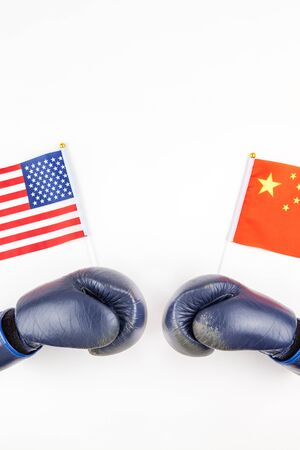 Creative top view flat lay of Two boxing gloves with China and USA flag and copy space on white background in minimal style. Concept of trade war between USA and China 스톡 콘텐츠