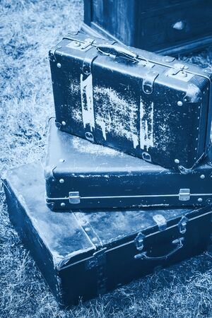 Old suitcases pile retro style. Color of the year 2020 classic blue toned
