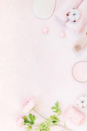 Spa, beauty cosmetics and body care treatment concept with copy space. Creative top view flat lay composition with bath accessories and rose soap cotton flowers, loofah on pink marble table background Zdjęcie Seryjne