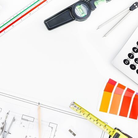 Creative flat lay overhead top view blueprint flat project plan hot coffee cup and office supplies on decorator table workspace swatches tools and equipment background copy space concept