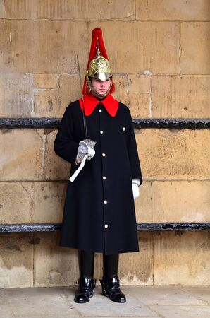 royals: Horseguard of Blues Royals on guard duty entrance to Horseguards Parade Whitehall Westminster London England UK United Kingdom