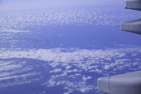 blue sky and cloudy view from window airplane fly high for transportation.