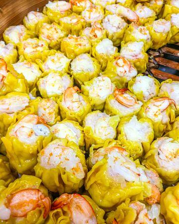 group of hot stream shrimp dumpling in big bamboo basket Stock Photo