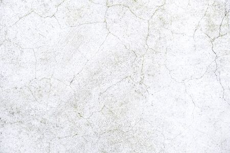 old cement crack and craze lines on white wall background