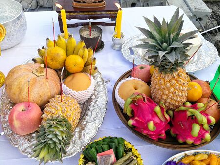 group of fruits on white table prepare for worship god buddhism. Thailand people belief tradition culture.