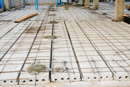strong iron wire on precast concrete slabs prepare for reinforce structure floor. rebar make net for use construction house site