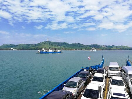 big boat ferry contain car and passenger across land and island. full carrier shipping transportaion on marine.