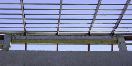 pattern on roof metal steel square frame structure for building construction concrete on sky background.
