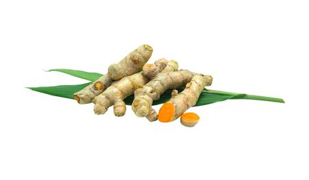 group of orange turmeric vegetable herb and spices thai food on green leaves. Isolated on white background with clipping path. Standard-Bild