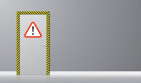 Industrial door with a triangle caution sign and striped yellow frame on a grey wall background. Restricted area with hazard warning icon. Safety horizontal background.