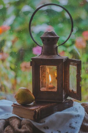 Vintage Lighting. Rainy day outside the window
