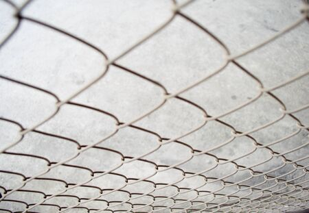 chained link fence: The steel cage.
