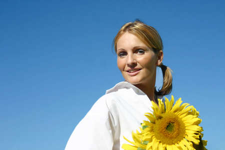 Beautiful Sunflower Woman and a blue sky. Stock Photo - 893269